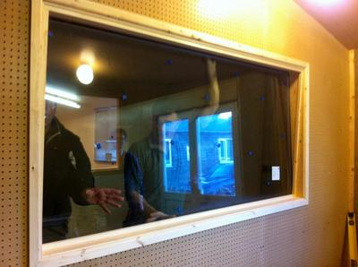 Fitted booth window (25 degrees angle) Note old style perforated board.