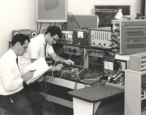 Universal Audio engineers bench testing the original 1176 Limiting Amplifier, circa 1967. UA still hand-builds every 1176 in Scotts Valley, CA